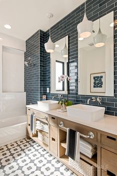 Blue tiles in shower, light wood vanity