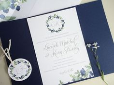 This invitation is printed on bright white 100% cotton stock, mounted on a navy blue gate fold card closed with a blueberry belly band and hang tag. Description from nooneyart.com. I searched for this on bing.com/images