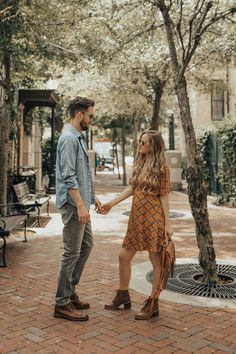 His and her fall outfits styled with retro inspired dress, lace up brown boots for her and grey jeans and casual brown boots for a casual men's outfit #mensfashion #mensstyle #womensfashion #hisandherfashion #hisandheroutfits