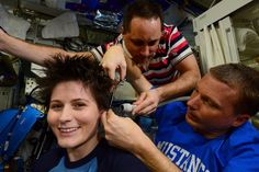 Getting a haircut in space! A New Year's haircut for ESA astronaut Samantha Cristoforetti in the challenging weightlessness of the International Space Station. Samantha's ISS Expedition 42 crewmate, NASA astronaut Terry Virts, puts his pre-flight haircutting training into practice. Their Russian colleague Anton Shkaplerov assists with the vacuum cleaner, making sure that no hair cuttings float off.