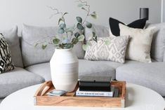 """tray on a coffee table is a good idea for a couple reasons. First, it keeps all of the items on your table together and organized. Items like your remote control, your favorite coffee table books, and even coasters work great displayed on your coffee table. I also added some """"secret storage"""" to the coffee table tray with the black box. This black box holds playing cards, so they're right at hand when you want to start a game in the living room. Boxes are always a good idea and HomeGoods has…"""