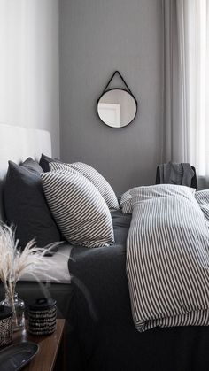H&M Home // Monochrome style with warm wooden furniture.