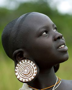 Africa | Young Surma woman with big earplugs, Omo Valley, Ethiopia