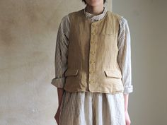 Vest with knitted back and striped lining