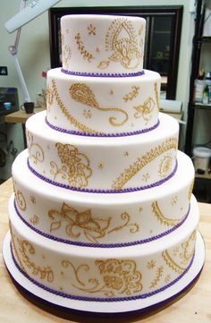 Gold piped Henna design Wedding Cake