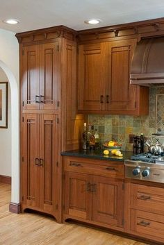 """Read More"""" Arts & & Crafts Kitchen with Ellsworth Door - kitchen area - take a look at the soffit over cupboards for electric cords?"""", """"Arts & & Cr"""