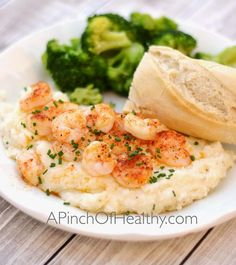 These garlic parmesan cheese grits are made on the stovetop, and they are a great side item to serve with shrimp, scallops or fish. | apinchofhealthy.com