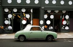 Cars time to go back to london town, jigsaw shop in notting hill. cars are overrated Nissan Figaro, Restaurants, Global Style, Shop Fronts, Cute Cars, Shop Window Displays, Visual Merchandising, Interior Architecture, Beautiful Places