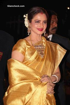 Rekha in gold saree, Bollywood