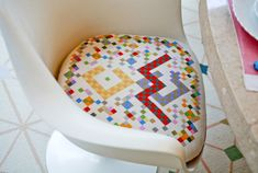 Needlepoint cushion for Eames Molded Plastic chair.