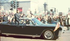 President John F. Kennedy in a limo riding down Chicago's Michigan Avenue. 1963.