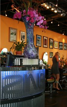 Zing - love the wall color in this hair salon with black or dark gray furniture