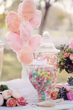 Adorable outdoor wedding dessert table display with gummy worms, jelly treats and cotton candy #wedding #weddingdessert #desserttable #candybar #sweets