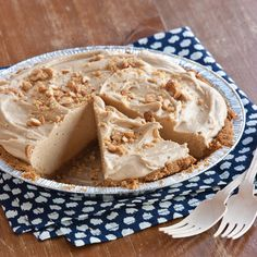 Peanut-Butter Pie Yield: 1 (9-inch) pie  1 (5-ounce) sleeve cinnamon Graham crackers (approximately 9 whole crackers) 1 cup salted roasted peanuts 2 tablespoons sugar 6 tablespoons butter, slightly softened 1½ cups creamy peanut butter 1 (8-ounce) package cream cheese, softened 1 cup confectioners' sugar, sifted 2 cups heavy whipping cream Garnish: chopped peanuts, and sweetened whipped cream