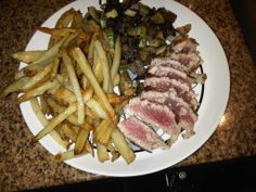 Seared yellow fin tuna with home fries and roasted vegetables. With Cabo San Lucas being a mecca for sport fishing, access to yummy yellow fin tuna at reasonable prices is guaranteed.