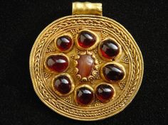 Golden pendant with grenades. Diameter 47 mm. Weight 20.4 gr.  Northern Black Sea Coast. SKIF, Sarmatians 5-th century AD