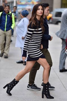 Lily Aldridge in a striped sweater dress  + mid calf boots