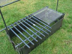 Firebox from The Blacksmith Shop (asking $600) No pegs to be driven into the ground... all self supporting. corner pegs hold box together and hold up grill bars, short walls held together by hanging bar supports. Grill bars slide easily to add/move coals.