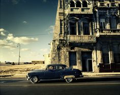 Outside Havana, an old American car with a new Japanese engine is used as a taxi.