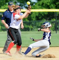 Annville- Cleona's Casey Ditzler attempts to make a play on Kutztown's Jodi Weaknecht during Thursday night's district championship game at Millersville. Kutztown beat Annville- Cleona 5-0. LEBANON DAILY NEWS - ASHLEY WALTER