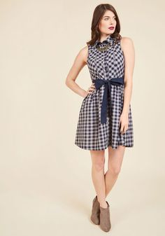 Your opinion piece is being published, and you're keeping cool in the face of such excitement by wearing this cotton dress! A ModCloth-exclusive design that boasts a sharp collar, button-up front, and a sash topping its gathered waist, this navy-and-grey plaid number's style ensures you look as polished as your written performance.