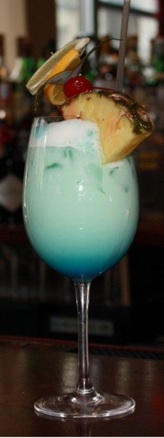 Swimming Pool Cocktail Recipe ~ Absolut Vodka, Malibu Rum, Pineapple Juice, Heavy Cream, Splash of Blue Curacao