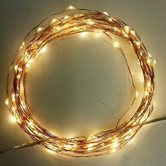 100 Fairy Lights on a 18-foot copper wire strand. Battery-operated or 110V plug-in string lights with a timer.  These are available in copper wire and in silver wire.  The silver wire is popular for weddings.  Most Christmas decorations seem to opt for copper.
