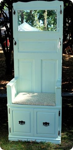 """Look at what you can make with a door, a cabinet, and some hooks.  You could find a 30"""" wide door and 30"""" wide cabinet at a home improvement store, attach them, trim them with baseboard, then prime and paint them both.   The mirror and cushioned seat are an added bonus.  What a marvelous hall tree for a foyer or narrow wall space.  This is another fabulous DIY project."""