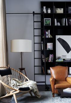 Coldplay guitarist Jonny Buckland brings a touch of rock-and-roll spirit to his family's Manhattan loft, enlisting a young design firm that loves to paint it black.