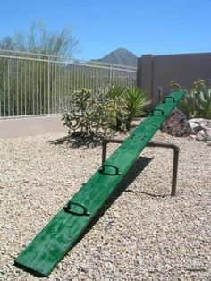 "teeter totter--- used to love it as a child.  one of the few ""items"" in the play area of the neighborhood. + swing"