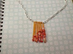 Milky orange glass beads. Gold seed beads. A simple head pin necklace by eyeDives on etsy.
