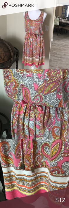 Delightful Pink Paisley Summer Dress SzM This adorable dress is so light and airy and CUTE! Imagine it with cork wedges and a floppy hat! Or flip flops or even white Ked's! Anyway you wear this, dressed up or down, you're sure to be comfortable - 100% soft viscose. Drawstring waist and key hole back - The hem accent is a luscious tile print and the colors on this cutie are pink, yellow, white, a scattering of black and juicy orange. Minimal wear evident - always hung to dry! 21 1/2 inches…