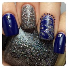 OPI OPI...Eurso Euro with OPI My Voice is A Little Norse. The clear for the watermarble is OPI Top Coat. Studs from Born Pretty store.