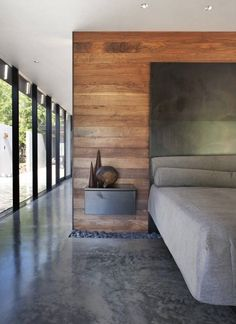 Love this modern bedroom Modern finish with concrete floors, pebble feature, wood accent wall with a metal headboard Heavy Metal / Hufft house design designs house design Metal Homes, Deco Design, Design Moderne, Design Design, Contemporary Bedroom, Bedroom Modern, Contemporary Homes, Minimalist Bedroom, Contemporary Cottage