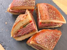 Classic New Orleans Muffuletta Sandwich | One of the signature flavors of New Orleans, the muffuletta is a sandwich that's tailor-made for picnics—it's big enough to serve multiple people (how many depends on your respective appetites), and it actually gets better if you make it ahead of time and let it sit at room temperature.	  #july4th #4thjuly #july4threcipes #seriouseats #recipes