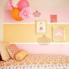 Sherbet pink and yellow girls room from cupcakemag - color scheme & use of pompoms