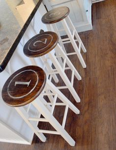 Using plain natural colored barstools to create a vintage feel with numbers. DIY barstools. Target hack.