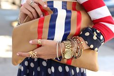Wrist full of bangles and an American Apparel leather clutch