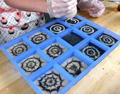 Spider web cold process soap in the 12 bar silicone mold.