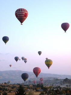 Waking up every morning to a sky fall of balloons - Cappadocia, Turkey