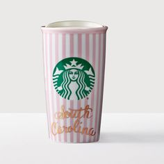 South Carolina Double Wall Traveler. A double-walled ceramic travel mug that wears its pink seersucker design with Southern charm.