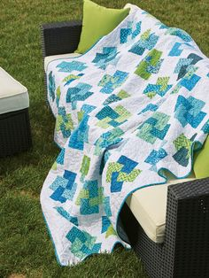 "GLAD ALL OVER by Debra Finan: Entwined blue and green prints seem to float in this quilt that works as a throw-size quilt pattern or bed-size quilt pattern. Designer Debra Finan made good use of pre-cut 2½"" strips of fabric, and the narrow sashing sets off the quilt blocks beautifully."