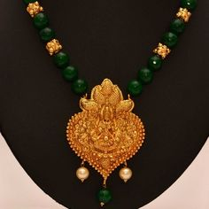 Anvi's lakshmi (temple jewellery) pendent with emeralds and gold beads