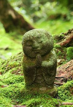 Small jizo statues in the moss garden at Sanzenin temple near Ohara