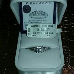 DIAMOND 14K WHITE GOLD DAZZLING RING Antique Vintage Style Diamond Ring  Keepsake sincerity Ring by Zales 14K White Gold  Stamped 14k  Clarity clear pure Comes with original tags. 498.00$ Clarity Card  1/2 CT Diamond  Ring was RESIZED TO 4.5  origanal size 7 professional resized by Zales I have a small wedding finger.  Comes with papers  Wrapped up and shipped with care Zales Jewelry Rings