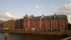 The Speicherstadt (lit. city of warehouses, meaning warehouse district) in Hamburg, Germany is the largest warehouse district in the world where the buildings stand on timber-pile foundations, oak logs, in this particular case. It is located in the port of Hamburg—within the HafenCity quarter—and was built from 1883 to 1927. The district was built as a free zone to transfer goods without paying customs. As of 2009 the district and the surrounding area is under redevelopment.
