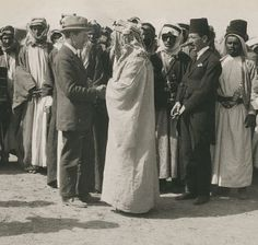 T.E. Lawrence, aka, Lawrence of Arabia. In the above photo, Lawrence is shown shaking hands with Amir Abdullah. The picture was taken at Abdullah's camp in the desert near Ahman Jordan in 1921.  Lawrence wore his normal clothes, instead of his Arabian outfit.