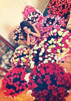 nikki. with flowers go her as im sorry