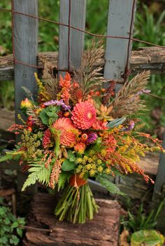Bridal bouquet featuring dahlias, pampas grass, succulents, and fennel. Too wild for you?