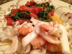 Smoke flavored sautéed calamari and shrimp with arugula and tomatoes:1/8/13